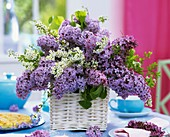 Arrangement of lilac and Spiraea in white basket