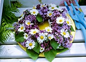 Wreath of ox-eye daisies and lilac