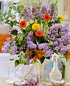 Lilac with wayfaring tree, gerberas and roses
