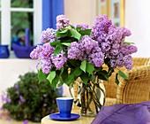 Purple lilac in glass jug