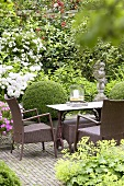 Garden furniture in summery garden