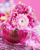 Pink spring arrangement of tulips and ranunculus