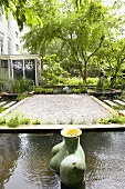 Garden complex with gravel areas and sculptural fountains in framed pools