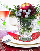 Christmas arrangement with apple on plate