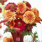 Vase of dahlias and other summer flowers