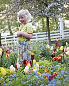 Blond girl in springtime garden