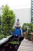 Zen garden with pond and Buddha figure