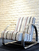 Upholstered chair with metal frame and spotted fabric