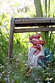 Hen figures on garden seat