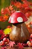 Wooden fly agaric among crab apples and Japanese maple