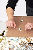 Making an upholstered stool (attaching upholstery button)