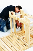 Making a wooden folding table (attaching the legs to the tabletop)