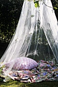 A place to sit under a mosquito net