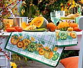 Table decoration of pumpkins and pumpkin candles