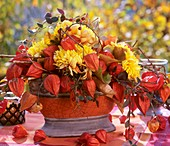 Arrangement of chrysanthemums and Chinese lanterns