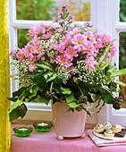 Vase of chrysanthemums, Michaelmas daisies and gypsophila