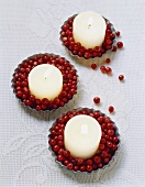 Candles and cranberries in tart tins