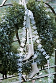 Evergreen wreath with ribbon and skates