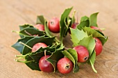 Christmas wreath of holly leaves and ornamental apples