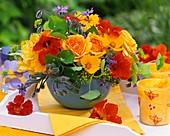 Arrangement of roses, nasturtiums and borage