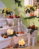 Staircase with Christmas decorations: candles, baskets of fruit etc.