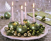 Advent wreath with green baubles as candle holders