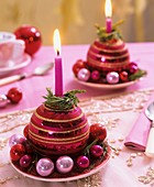 Christmas baubles used as candle holders