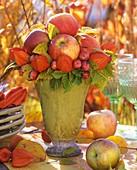 Arrangement of apples, crab apples, Chinese lanterns & hornbeam
