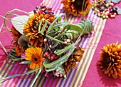 Bouquet of rudbeckia, calendula, viburnum berries & grasses