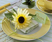 Place-setting with sunflower and place card
