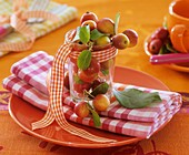Crab apples in jar on checked napkin