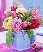 Arrangement of hyacinths, ranunculus, tulips & bilberry twigs