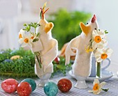 Felt chicken egg cosies with small posies of narcissi