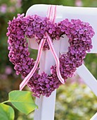 Heart-shaped lilac wreath tied to chair back