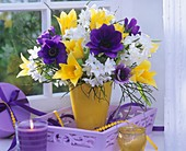 Vase of anemones, tulips and narcissi on tray