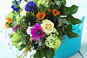 Summer bouquet of poppy anemones, roses and viburnum