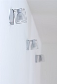 Small designer spotlights mounted on wall