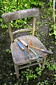 Garden tools on old wooden chair