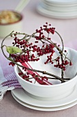 Place-setting with a heart of viburnum twigs and berries