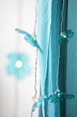 Close-up of turquoise fairy lights