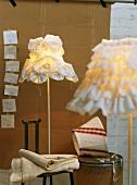 Standard lamps with original lampshades in light designer's workshop