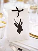 Paper bag with animal silhouette used as place card