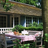 Traditional house with terrace and garden furniture