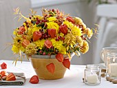 Arrangement of autumn flowers and rose hips