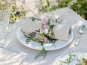 Napkin ring of sweet peas and vetch tendrils
