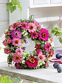 Wreath of late summer flowers in pink and green