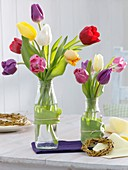 Tulips in glass bottles, small wreath of weeping willow