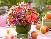 Arrangement of late summer flowers on garden table
