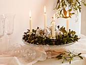 Advent wreath of mistletoe with white candles and glass baubles