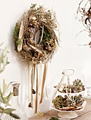 Wall wreath of twigs, dried fruit and Christmas tree ornaments